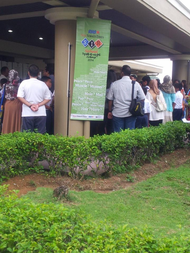 upportive parents and teachers waiting to register their children / students at the entrance of Dewan Serbaguna, Politeknik Sultan Salahuddin Abdul Aziz Shah, Shah Alam.